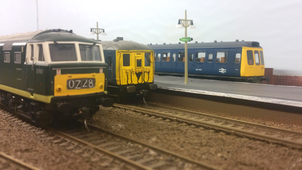 2-Bil #2046 and a Class 117 DMU wait to depart Blackhurst, whilst Hymek #D7017 sits on the loop.