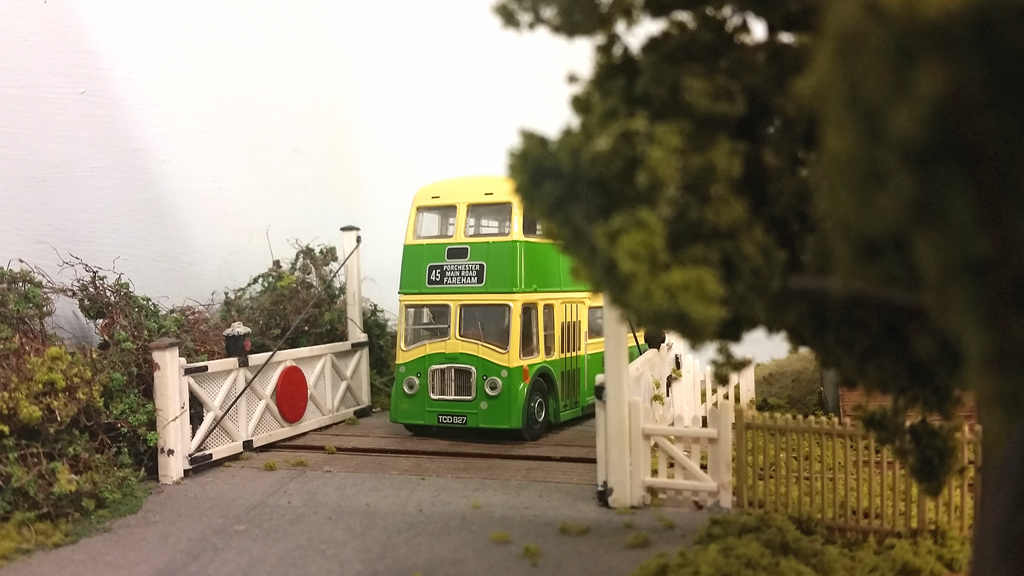 A Southdown Queen Mary bus crosses the disused level crossing